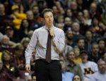Minnesota head coach Richard Pitino loosens his tie during the second half of an NCAA college basketball game against Purdue in Minneapolis, Wednesday, Jan. 27, 2016. Purdue won 68-64. (AP Photo/Ann Heisenfelt)