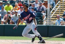 Minnesota Twins' Byron Buxton follows through on a swing against the Boston Red Sox in a spring training baseball game, Thursday, March 31, 2016, in Fort Myers, Fla. (AP Photo/Tony Gutierrez)