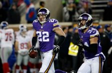 Minnesota Vikings free safety Harrison Smith (22) holds his interception that he ran back for a touchdown during the first half of an NFL football game against the New York Giants, Sunday, Dec. 27, 2015, in Minneapolis. (AP Photo/Ann Heisenfelt)