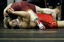 Maryland's Louis Mascola, bottom, competes with Minnesota's Brandon Kingsley ,top, in a 157 pound weight class match during the Big Ten Wrestling Championships at Carver-Hawkeye Arena in Iowa City, Iowa, on Saturday, March 5, 2016. (AP Photo/Matthew Holst)