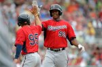 Minnesota Twins  Adam Walker (99) is greeted by Adam Pettersen (95) after the two scored on Walker's  two-run homer during the seventh inning of an exhibition baseball game against the Boston Red Sox in Fort Myers, Fla., Saturday, March 29, 2014. (AP Photo/Gerald Herbert)