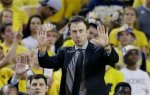 Minnesota head coach Richard Pitino signals from the sidelines during the second half of an NCAA college basketball game against Michigan, Wednesday, Jan. 20, 2016 in Ann Arbor, Mich. (AP Photo/Carlos Osorio)
