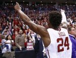 FILE - In this March 20, 2016, file photo, Oklahoma guard Buddy Hield (24) gestures to the Oklahoma crowd following a second-round men's college basketball game against VCU in the NCAA Tournament, in Oklahoma City. Buddy Hield had big expectations when he returned to Oklahoma for his senior season.Things have gone even better than expected. The sharpshooting guard has averaged 29.3 points in the NCAA Tournament heading into the Sooners' national semifinal Saturday against Villanova. (AP Photo/Alonzo Adams)