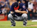 Minnesota Twins pitcher Glen Perkins reacts after giving up a two-run home run to Detroit Tigers' Rajai Davis during the eighth inning of a baseball game at Comerica Park, Friday, Sept. 25, 2015, in Detroit. (AP Photo/Duane Burleson)