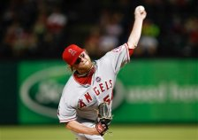 Los Angeles Angels relief pitcher Buddy Boshers (54) delivers a pitch to the Texas Rangers during the sixth inning of a baseball game, Thursday, Sept. 26, 2013, in Arlington, Texas. (AP Photo/Jim Cowsert)