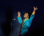 Prince performs during the halftime show at Super Bowl XLI at Dolphin Stadium in Miami, Sunday, Feb. 4, 2007. (AP Photo/Alex Brandon)