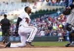 Minnesota Twins' Eduardo Nunez smiles after he scored on an inside-the-park home run off Tampa Bay Rays pitcher Matt Moore during the first inning of a baseball game Thursday, June 2, 2016, in Minneapolis. (AP Photo/Jim Mone)