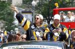 Pittsburgh Penguins' Carl Hagelin, left, and Phil Kessel acknowledge fans along the victory parade route in Pittsburgh, Pa., Wednesday, June 15, 2016. The Penguins defeated the San Jose Sharks on Sunday to win the NHL hockey championship. (AP Photo/Keith Srakocic)