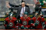 Minnesota Wild head coach Mike Yeo calls out to his players during the third period of an NHL hockey game against the Winnipeg Jets in St. Paul, Minn., Tuesday, Nov. 10, 2015. The Wild won 5-3. (AP Photo/Ann Heisenfelt)