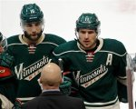 Minnesota Wild left wing Zach Parise, right, and Minnesota Wild left wing Jason Zucker, left, listen to Minnesota Wild head coach Mike Yeo during the third period of Game 3 of an NHL hockey first-round playoff series game against the St. Louis Blues in St. Paul, Minn., Monday, April 20, 2015. The Wild won 3-0. (AP Photo/Ann Heisenfelt)