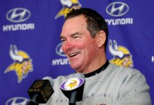 Minnesota Vikings head coach Mike Zimmer smiles during a media availability after an NFL football game against the New York Giants, Sunday, Dec. 27, 2015, in Minneapolis. The Vikings won 49-17. (AP Photo/Ann Heisenfelt)