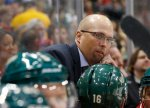Minnesota Wild head coach Mike Yeo watches his team from the bench during the second period of an NHL preseason hockey game against the Buffalo Sabres in St. Paul, Minn., Thursday, Oct. 1, 2015. (AP Photo/Ann Heisenfelt)
