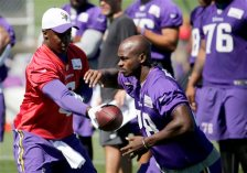 Minnesota Vikings quarterback Teddy Bridgewater hands the ball off to running back Adrian Peterson during practice at an NFL football training camp on the campus of Minnesota State University Wednesday, July 29, 2015, in Mankato, Minn. (AP Photo/Charles Rex Arbogast)