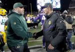 FILE - In this Nov. 22, 2015, file photo, Green Bay Packers head coach Mike McCarthy, left, meets with Minnesota Vikings head coach Mike Zimmer following their NFL football game in Minneapolis. The two teams meet at Lambeau Field on Sunday night to determine the NFC North champion. (AP Photo/Ann Heisenfelt, File)