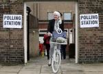 FILE - In this Thursday, June 23, 2016 file photo, a woman on a bicycle leaves a polling station near to the Royal Chelsea Hospital, London Thursday June 23, 2016. Voters in Britain are deciding Thursday whether the country should remain in the European Union. (Daniel Leal-Olivas/PA via AP, File) UNITED KINGDOM OUT - NO SALES - NO ARCHIVE