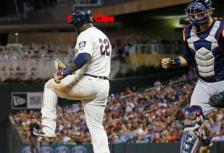 Atlanta Braves catcher A.J. Pierzynski, right, pumps his fist as Minnesota Twins' Miguel Sano, left, breaks his bat over his leg after striking out to end the eighth inning of a baseball game Wednesday, July 27, 2016, in Minneapolis. The Braves won 9-7. (AP Photo/Jim Mone)