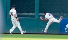 Minnesota Twins center fielder Byron Buxton (25) makes a running catch of a fly ball by Chicago White Sox's Jose Abreu during the fourth inning of an baseball game Saturday, July 30, 2016, in Minneapolis. Twins' Robbie Grossman is at left. (AP Photo/Paul Battaglia)