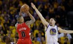 Portland Trail Blazers' Damian Lillard (0) shoots over Golden State Warriors' Klay Thompson (11) during the second half in Game 5 of a second-round NBA basketball playoff series Wednesday, May 11, 2016, in Oakland, Calif. Golden State won 125-121. (AP Photo/Marcio Jose Sanchez)