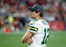 Green Bay Packers quarterback Aaron Rodgers (12) watches from the sidelines against the Arizona Cardinals during the second half of an NFL football game, Sunday, Dec. 27, 2015, in Glendale, Ariz. (AP Photo/Ross D. Franklin)