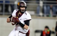 Minnesota quarterback Mitch Leidner drops back to pass against Ohio State during the first quarter of an NCAA college football game Saturday, Nov. 7, 2015, in Columbus, Ohio. (AP Photo/Paul Vernon)
