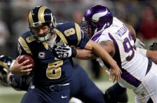 St. Louis Rams quarterback Sam Bradford, left, is able to slip away from the grasp of Minnesota Vikings defensive tackle Kevin Williams during the fourth quarter of an NFL football game Sunday, Dec. 16, 2012, in St. Louis. (AP Photo/Tom Gannam)