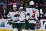 Minnesota Wild left wing Zach Parise, center, celebrates scoring a goal with defenseman Ryan Suter, left, and center Charlie Coyle against the Colorado Avalanche in the third period of an NHL hockey game Saturday, March 26, 2016, in Denver. The Wild won 4-0. (AP Photo/David Zalubowski)