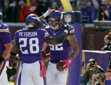 Minnesota Vikings running back Adrian Peterson (28) and tight end Kyle Rudolph (82) celebrate Rudolph's touchdown during the first half of an NFL football game against the Kansas City Chiefs, Sunday, Oct. 18, 2015, in Minneapolis. (AP Photo/Ann Heisenfelt)
