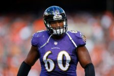 Baltimore Ravens tackle Eugene Monroe (60) walks to the locker room during an NFL game at the FirstEnergy Stadium in Cleveland on Sunday, Sept. 21, 2014. (Jeff Haynes/AP Images for Panini)