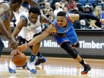 Minnesota Timberwolves' Andrew Wiggins, left, and Oklahoma City Thunder's Russell Westbrook chase the ball in the second half of an NBA basketball game, Tuesday, Jan. 12, 2016, in Minneapolis. The Thunder won 101-96. (AP Photo/Jim Mone)