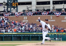 Detroit Tigers relief pitcher Joe Nathan throws warmup pitches as the timer ticks off during the ninth inning of an opening day baseball game against the Minnesota Twins in Detroit, Monday, April 6, 2015. (AP Photo/Carlos Osorio)