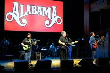 "From left, artists Jeff Cook, Randy Owen and Teddy Gentry of Alabama perform at ""The Big Gig"" concert at the Country Music Hall of Fame and Museum on Wednesday, July 6, 2016, in Nashville, Tenn. (Photo by Laura Roberts/Invision/AP)"