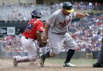 Oakland Athletics' Billy Butler, right, beats the tag by Minnesota Twins' Juan Centeno to score on a two-run single by Coco Crisp off Twins pitcher Taylor Rogers in the seventh inning of a baseball game Monday, July 4, 2016, in Minneapolis. (AP Photo/Jim Mone)