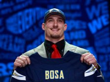 Ohio State's Joey Bosa poses for photos after being selected by the San Diego Chargers as the third pick in the first round of the 2016 NFL football draft, Thursday, April 28, 2016, in Chicago.(Jeff Haynes/AP Images for Panini)