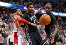 Washington Wizards guard Garrett Temple, left, and Minnesota Timberwolves center Karl-Anthony Towns (32) and center Gorgui Dieng go for the rebound during the second overtime of an NBA basketball game Friday, March 25, 2016, in Washington. The Timberwolves won 132-129. (AP Photo/Alex Brandon)