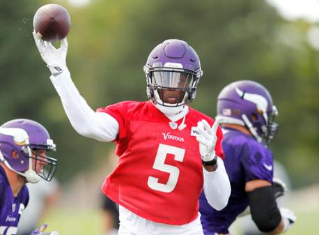 Minnesota Vikings quarterback Teddy Bridgewater (5) throws during the second day of the team's NFL football training camp at Mankato State University in Mankato, Minn. on Saturday, July, 30, 2016. (AP Photo/Andy Clayton-King)