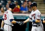 Minnesota Twins' Joe Mauer (7) gets congratulations from Max Kepler after hitting a solo home run off Cleveland Indians relief pitcher Andrew Miller during the eighth inning of a baseball game, Monday, Aug. 1, 2016, in Cleveland. (AP Photo/Ron Schwane)