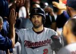 Minnesota Twins' Brian Dozier (2) gets congratulations from teammates after hitting a three-run home run off Cleveland Indians relief pitcher Dan Otero during the ninth inning of a baseball game Wednesday, Aug. 3, 2016, in Cleveland. The Twins won 13-5. (AP Photo/Ron Schwane)