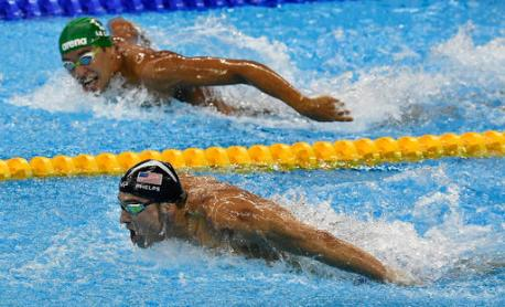 South Africa's Chad Le Clos, top, looks to United States' gold medal winner Michael Phelps in the men's 200-meter butterfly final during the swimming competitions at the 2016 Summer Olympics, Tuesday, Aug. 9, 2016, in Rio de Janeiro, Brazil. (AP Photo/Martin Meissner)