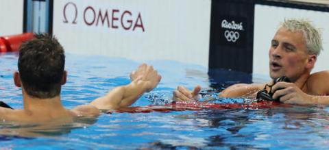 United States' Michael Phelps, left, celebrates winning a semifinal of the men's 200-meter individual medley ahead of second placed United States' Ryan Lochte, right, during the swimming competitions at the 2016 Summer Olympics, Wednesday, Aug. 10, 2016, in Rio de Janeiro, Brazil. (AP Photo/Lee Jin-man)