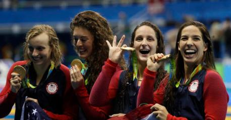 United States' Katie Ledecky, Allison Schmitt, Leah Smith and Maya DiRado, from left, hold up their gold medals during the women's 4 x 200-meter freestyle relay medals ceremony during the swimming competitions at the 2016 Summer Olympics, Thursday, Aug. 11, 2016, in Rio de Janeiro, Brazil. (AP Photo/David J. Phillip )
