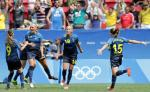 Sweden's Stina Blackstenius, 11, with teammates after scoring her team's first goal during a quarter-final match of the women's Olympic football tournament between the United States and Sweden in Brasilia Friday Aug. 12, 2016.(AP Photo/Eraldo Peres)