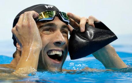 United States' Michael Phelps reacts after the men's 100-meter butterfly final during the swimming competitions at the 2016 Summer Olympics, Friday, Aug. 12, 2016, in Rio de Janeiro, Brazil. (AP Photo/Michael Sohn)