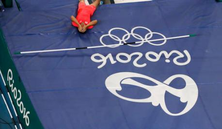 Japan's Hiroki Ogita reacts after a failed attempt during a pole vault qualifying round at the athletics competitions of the 2016 Summer Olympics at the Olympic stadium in Rio de Janeiro, Brazil, Saturday, Aug. 13, 2016. (AP Photo/Morry Gash)