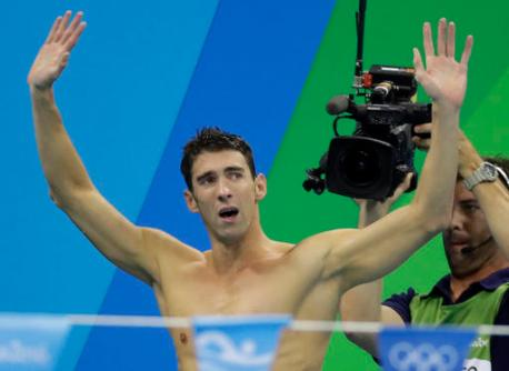 United States Michael Phelps acknowledges the crowd after his team won gold in the men's 4 x 100-meter medley relay final during the swimming competitions at the 2016 Summer Olympics, Saturday, Aug. 13, 2016, in Rio de Janeiro, Brazil. (AP Photo/Rebecca Blackwell)