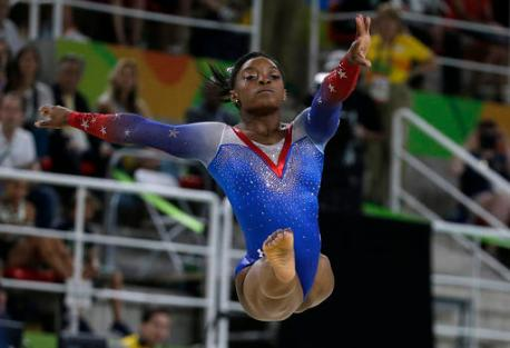 United States' Simone Biles performs on the floor during the artistic gymnastics women's apparatus final at the 2016 Summer Olympics in Rio de Janeiro, Brazil, Tuesday, Aug. 16, 2016. (AP Photo/Rebecca Blackwell)