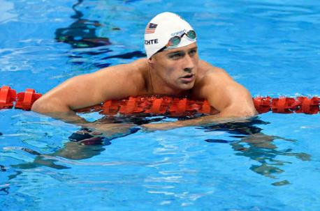 FILE - In this Aug. 9, 2016, file photo, United States' Ryan Lochte checks his time after a men' 4x200-meter freestyle relay heat during the swimming competitions at the 2016 Summer Olympics in Rio de Janeiro, Brazil. A Brazilian police official told The Associated Press that Lochte fabricated a story about being robbed at gunpoint in Rio de Janeiro.   (AP Photo/Martin Meissner, File)