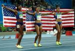 Gold medal winner Brianna Rollins, silver medal winner, Nia Ali and bronze medal winner Kristi Castlin, all from the United States, pose with their country's flag after the 100-meter hurdles final, during the athletics competitions of the 2016 Summer Olympics at the Olympic stadium in Rio de Janeiro, Brazil, Wednesday, Aug. 17, 2016. (AP Photo/Matt Dunham)