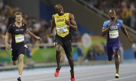 Usain Bolt from Jamaica, center, crosses the line to win the gold medal in the men's 200-meter final ahead of third placed France's Christophe Lemaitre, left, during the athletics competitions of the 2016 Summer Olympics at the Olympic stadium in Rio de Janeiro, Brazil, Thursday, Aug. 18, 2016. (AP Photo/David J. Phillip)