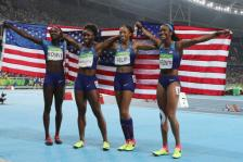 The United States team from left, Tori Bowie, Tianna Bartoletta, Allyson Felix and English Gardner celebrate winning the gold medal in the women's 4x100-meter relay final during the athletics competitions of the 2016 Summer Olympics at the Olympic stadium in Rio de Janeiro, Brazil, Friday, Aug. 19, 2016. (AP Photo/Lee Jin-man)