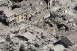 Rescuers search amid rubble following an earthquake in Amatrice Italy, Wednesday, Aug. 24, 2016. The magnitude 6 quake struck at 3:36 a.m. (0136 GMT) and was felt across a broad swath of central Italy, including Rome where residents of the capital felt a long swaying followed by aftershocks. (AP Photo/Gregorio Borgia)